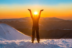 Woman on the top of winter mountain Stock Photo