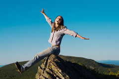 Woman on top of the wold Royalty Free Stock Photo