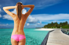 Woman topless on beautiful beach with jetty Royalty Free Stock Images