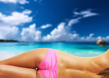 Woman topless on beautiful beach at Seychelles Royalty Free Stock Photo