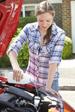 Woman Topping Up Windshield Washer Fluid In Car Royalty Free Stock Image