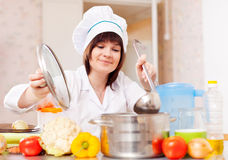 Woman in toque cooks with ladle Royalty Free Stock Image