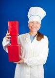 Woman in toque with red  plastic packages Stock Photography