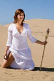 Woman with torch in the sand Royalty Free Stock Photography