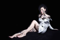 Woman in torn dress, long legs, dirty Royalty Free Stock Photo