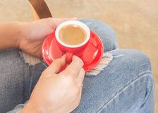 Woman in torn jeans sitting at coffee shop Royalty Free Stock Image