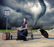 Woman and tornado. Woman,waiting a bus and tornado (photo and hand-drawing elements compilation Stock Images