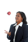 Woman Tossing Apple Royalty Free Stock Photography