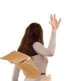 Woman tossing aside papers in anger. Temperamental woman tossing aside papers in anger as she storms off after a disagreement, isolated on white Royalty Free Stock Photo