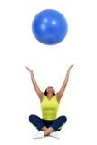 Woman tossing blue ball Stock Photo