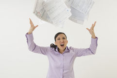 Woman Tossing Forms In The Air Stock Photo