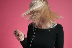 Woman Tossing Hair While Listening To Music Royalty Free Stock Image