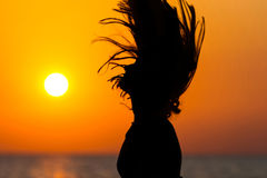 Woman tossing hair at sunset Royalty Free Stock Image