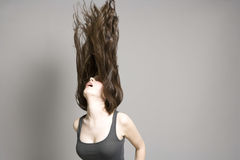 Woman Tossing Long Brown Wavy Hair Stock Photography
