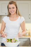 Woman tossing salad Royalty Free Stock Photos