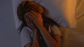 Woman tossing and turning in bed, hardly morning wake up, insomnia, top view. Stock footage stock video footage
