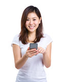 Woman touch on cellphone Stock Images