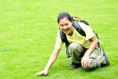 Woman touch grass Stock Images
