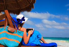 Woman with touch pad on tropical beach Stock Photo