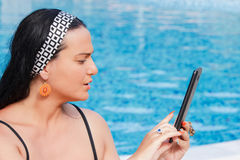 Woman with touch pad on vacation Royalty Free Stock Photo