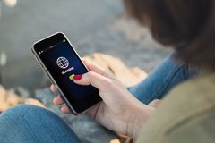 Woman touch the screen of her smartphone showing roaming Royalty Free Stock Photo