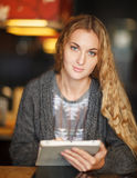 Woman with touch screen tablet computer in cafe Royalty Free Stock Photo