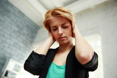 Woman touched her head with closed eyes Stock Images