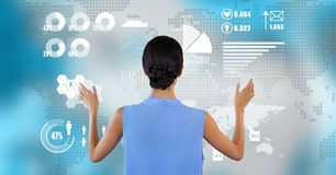 Woman touches graph on map. Digital composite of Woman touches graph on map Royalty Free Stock Photo