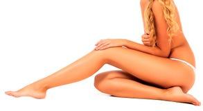 Woman touches her leg Stock Photos
