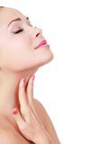 Woman touches her neck Royalty Free Stock Images