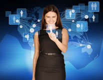 Woman touches icon people on background of world Royalty Free Stock Photography
