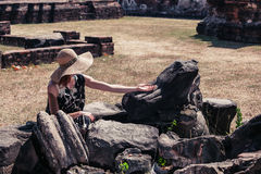 Woman touching ancient ruins Stock Photography