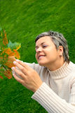 Woman touching autumn leaf Stock Image