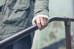 Woman touching banister outside Stock Photography