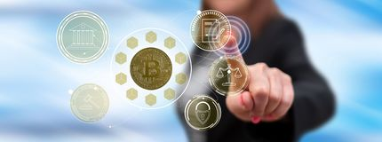 Woman touching a bitcoin regulation concept. On a touch screen with her finger royalty free stock image