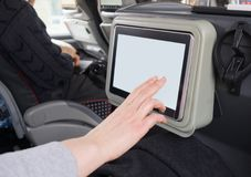 Woman touching blank lcd screen. Woman touching blank lcd screen in the travel coach Stock Photography