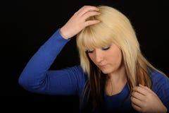 Woman touching blond hair stock image