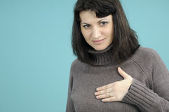 Woman touching breast Royalty Free Stock Image