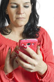 Woman touching and browsing her smart phone. Royalty Free Stock Photo