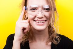 Woman touching a button on futuristic smart glasses Royalty Free Stock Photos