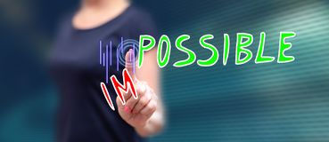 Woman touching a challenge concept stock image