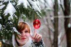 Woman Touching Christmas Ball Royalty Free Stock Image