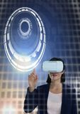 Woman touching circle interface with Virtual reality headset. Digital composite of Woman touching circle interface with Virtual reality headset Stock Photography