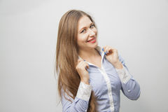 Woman touching collar of the shirt Stock Images