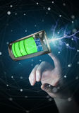 Woman touching 3D render battery with lightning with her finger. Woman on blurred background touching 3D render battery with lightning with her finger Stock Photo