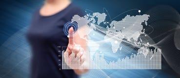 Woman touching a digital marketing statistics concept stock image