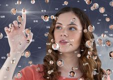 Woman touching digitally generated social networking icons Stock Photo