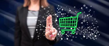 Woman touching an e-commerce concept. On a touch screen with her fingers royalty free stock photo