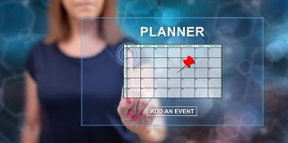 Woman touching an event adding on planner concept. On a touch screen with her finger stock photos