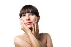 Woman touching face Stock Image